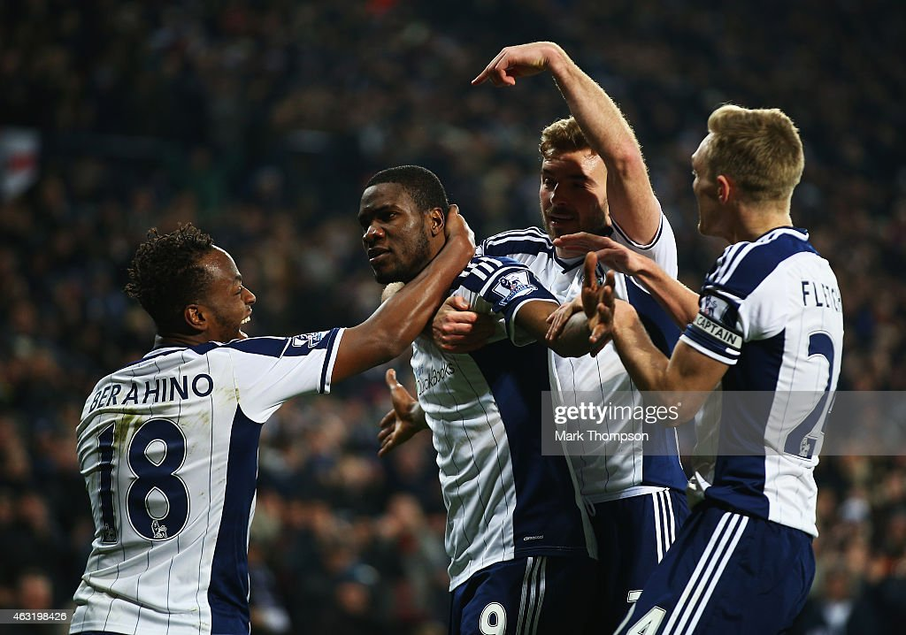 Brown Ideye of West Brom celebrates scoring the opening goal with team mates during the Barclays Premier League match between West Bromwich Albion...