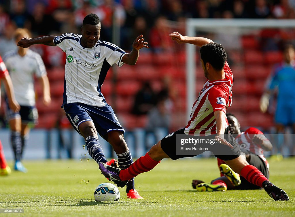Brown Ideye of West Brom is tackled by Jack Cork of Southampton during the Barclays Premier League match between Southampton and West Bromwich Albion at St Mary's Stadium on August 23, 2014 in Southampton, England.