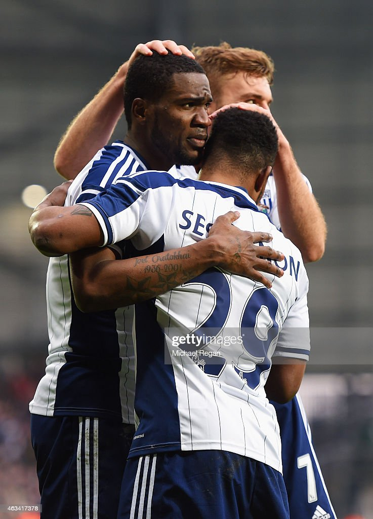 <a gi-track='captionPersonalityLinkClicked' href=/galleries/search?phrase=Brown+Ideye&family=editorial&specificpeople=4417854 ng-click='$event.stopPropagation()'>Brown Ideye</a> of West Bromwich Albion (L) celebrates with Stephane Sessegnon (29) and <a gi-track='captionPersonalityLinkClicked' href=/galleries/search?phrase=James+Morrison+-+Fu%C3%9Fballspieler&family=editorial&specificpeople=4427611 ng-click='$event.stopPropagation()'>James Morrison</a> (7) as he scores their third goal during the FA Cup Fifth Round match between West Bromwich Albion and West Ham United at The Hawthorns on February 14, 2015 in West Bromwich, England.