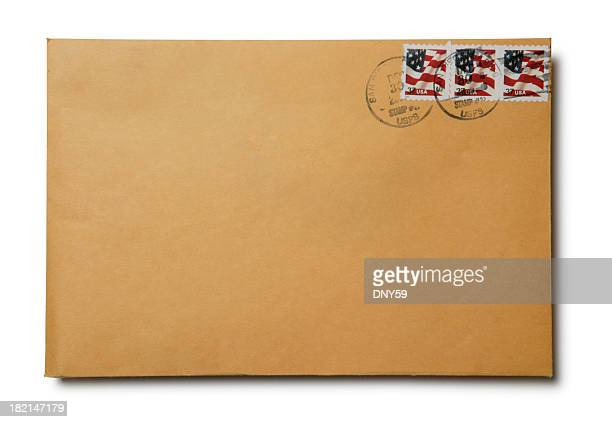 Brown kraft envelope with canceled U.S. stamps on white background