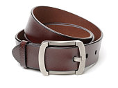 Brown leather belt  on white background closeup