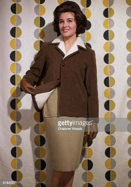 A brown leather lightweight sheepskin jacket worn over a slim beige skirt
