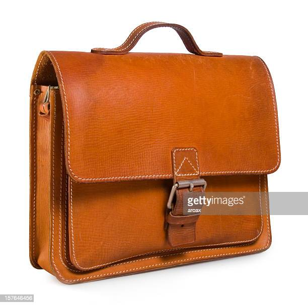 Brown leather satchel against a plain white background