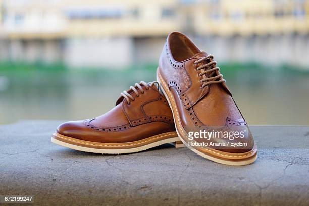 Brown Leather Shoes On Wall