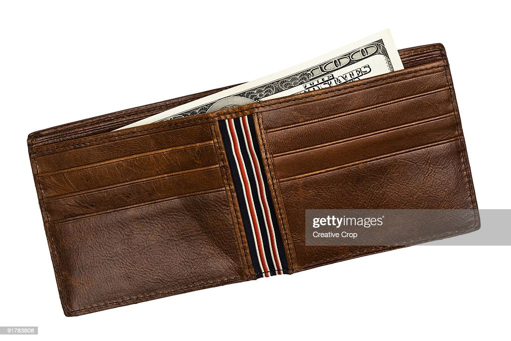 Brown leather wallet containing $100 notes