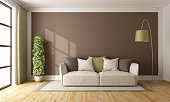 Brown living room with sofa on carpet and floor lamp - 3d rendering
