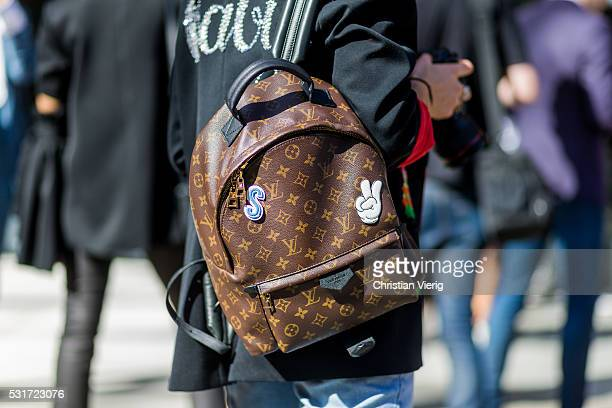 A brown Louis Vuitton backpack with patches outside Ginger Smart at MercedesBenz Fashion Week Resort 17 Collections at Carriageworks on May 16 2016...