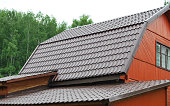 Brown metal roof of the house