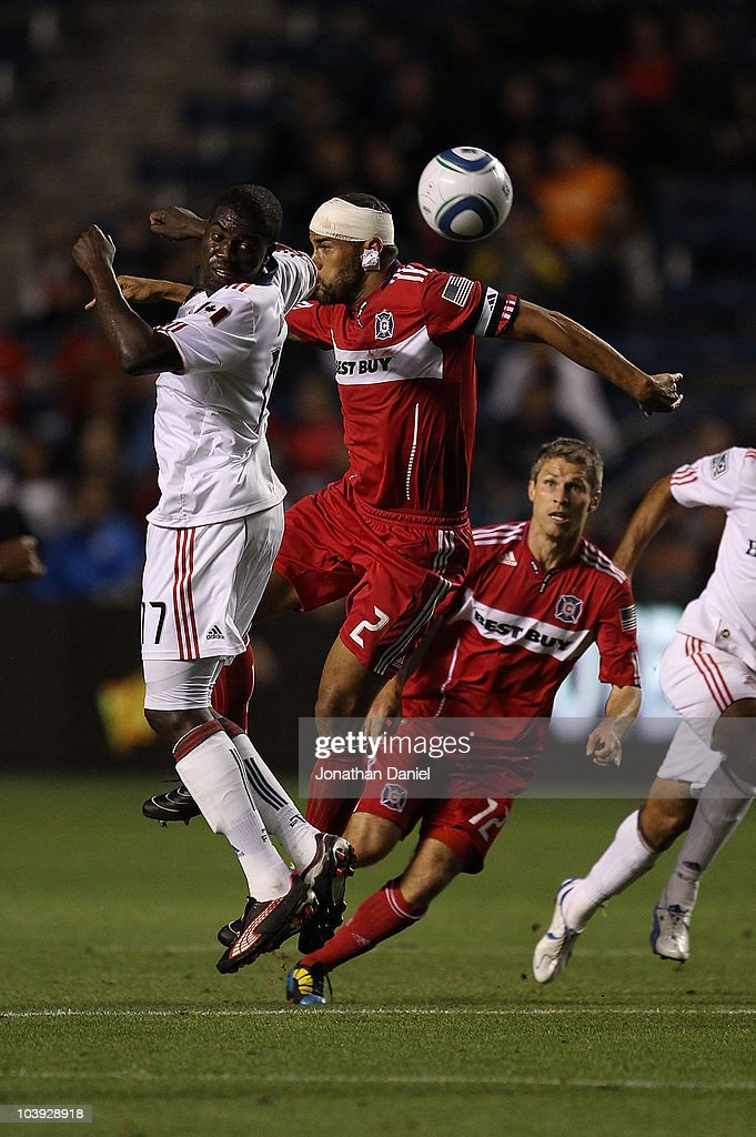 C.J. Brown #2 of the Chicago Fire, whose head was taped after a collision, battles for a header with O'Brain White #17 of Toronto FC above Logan Pause #12 in an MLS match on September 8, 2010 at Toyota Park in Bridgeview, Illinois.