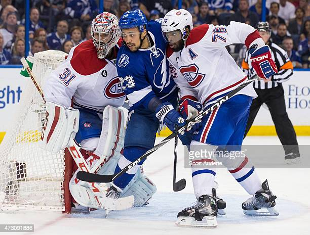 JT Brown of the Tampa Bay Lightning battles against goalie Carey Price and PK Subban of the Montreal Canadiens during the third period in Game Six of...