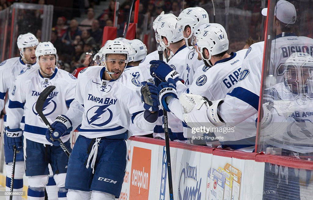 J.T. Brown #23 of the Tampa Bay Lightning celebrates his first period goal against the Ottawa Senators with teammates at the players bench at Canadian Tire Centre on February 8, 2016 in Ottawa, Ontario, Canada.