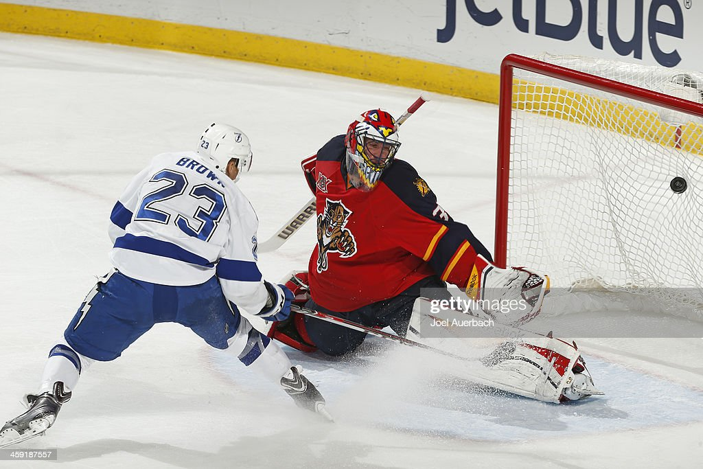 T Brown of the Tampa Bay Lightning scores the final goal against goaltender Scott Clemmensen of the Florida Panthers at the BBT Center on December 23...