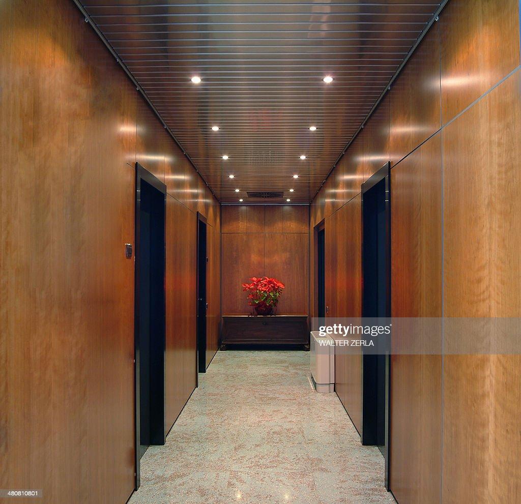 Brown panelling and doors in corridor
