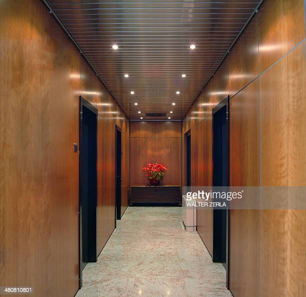 Brown panelling and doors in corridor