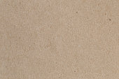 Brown paper, cardboard texture for background.