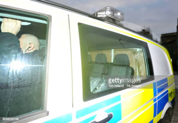 Brown paper covers the rear of a police van believed to be carrying Vincent Tabak as it arrives at speed the wrong way up a one way street with...