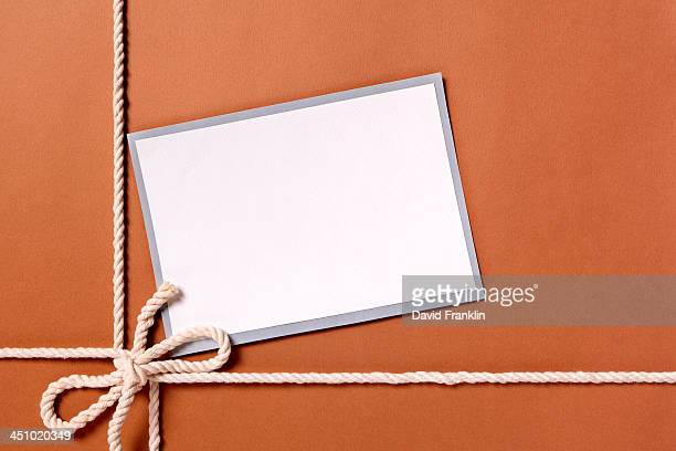 Brown paper package with white string and label