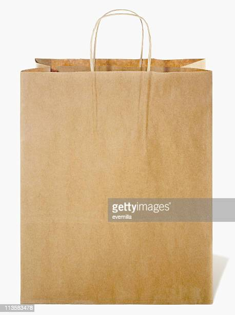 brown paper shopping bag cut out on white