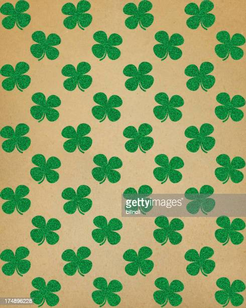 brown paper with glitter clover pattern