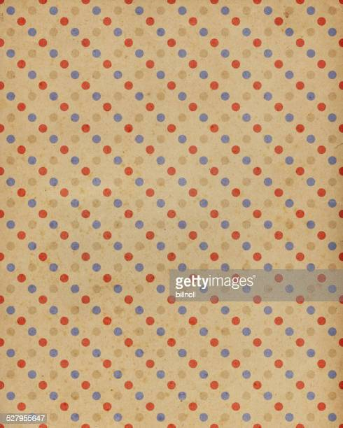 brown paper with red, brown and blue dots