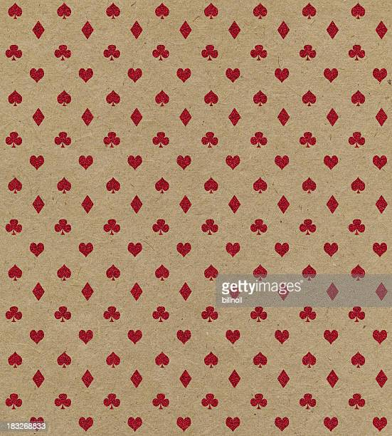brown paper with red glitter playing card symbols