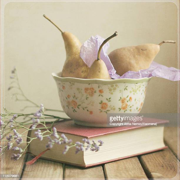 Brown pears and book