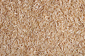 Brown rice texture close-up (raw food ingredient). Can be used as a background.