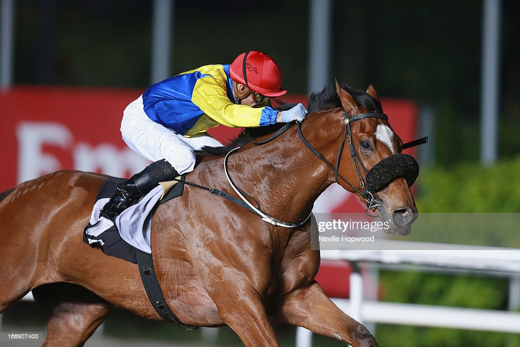 CW Brown rides <a gi-track='captionPersonalityLinkClicked' href=/galleries/search?phrase=Goliath&family=editorial&specificpeople=78482 ng-click='$event.stopPropagation()'>Goliath</a> to win The Hornet 2008 Stakes during Singapore racing at Kranji on May 17, 2013 in Singapore.