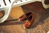 Brown Shoes Next to Deckchair, High Angle View, Close Up