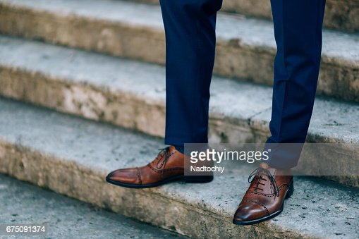 Brown shoes on male legs : Stock Photo
