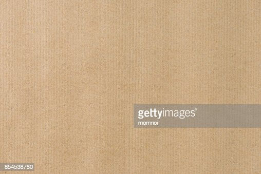Brown striped recycle paper texture for wraping. Kraft paper : Stock Photo