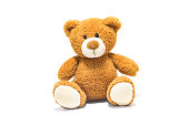 Brown teddy bear isolated in front of a white background.