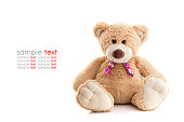 Close up brown teddy bear isolated on white background