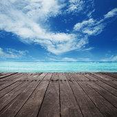 platform beside sea with blue sky