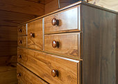 Brown wooden tallboy chest of drawers