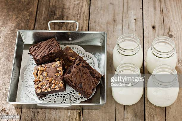 Brownies In A Tin Container And Glasses of Milk