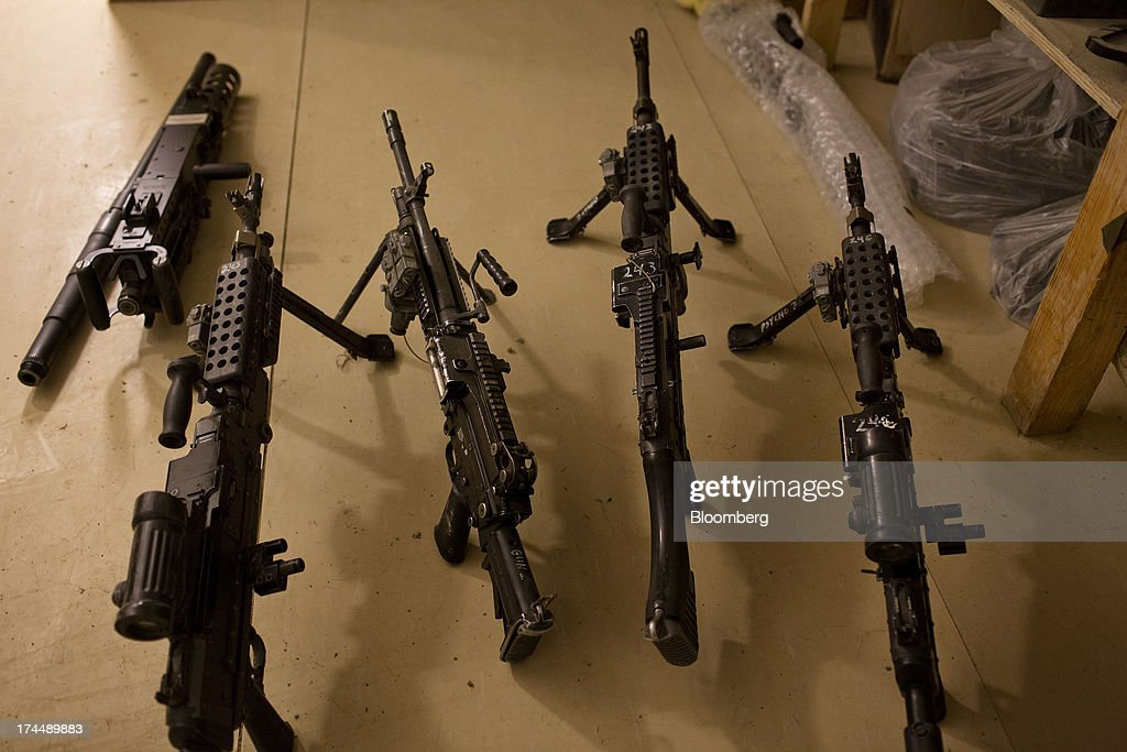 A Browning .50 Caliber Machine gun, left, and M240 Machine guns are lined up for cleaning in the barracks of 2nd Platoon Fox Co. of the 2-506th Infantry Battalion of the 4th Brigade of the 101st Airborne Division attend a mission brief at their base at COP Sabari in the Sabari district of Khost province, Afghanistan, on Saturday, June 29, 2013. U.S. President Barack Obama has maintained his position of ending U.S. combat in Afghanistan by the end of next year, though that plan has included keeping in place several thousand troops for support. Photographer: Victor J. Blue/Bloomberg via Getty Images