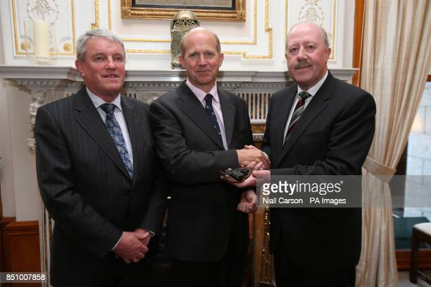 A Browning pistol belonging to Lord Mountbatten is handed over to British Ambassador Dominick Chilcott by Garda Commissioner Martin Callinan and Brig...
