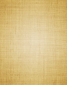Brownish canvas background with light in the center