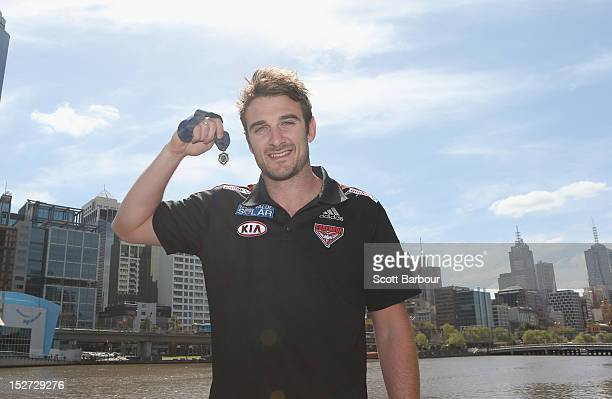 Brownlow Medallist Jobe Watson of the Essendon Bombers AFL team poses holding the Brownlow Meda at a press conference at Crown Promenade on September...