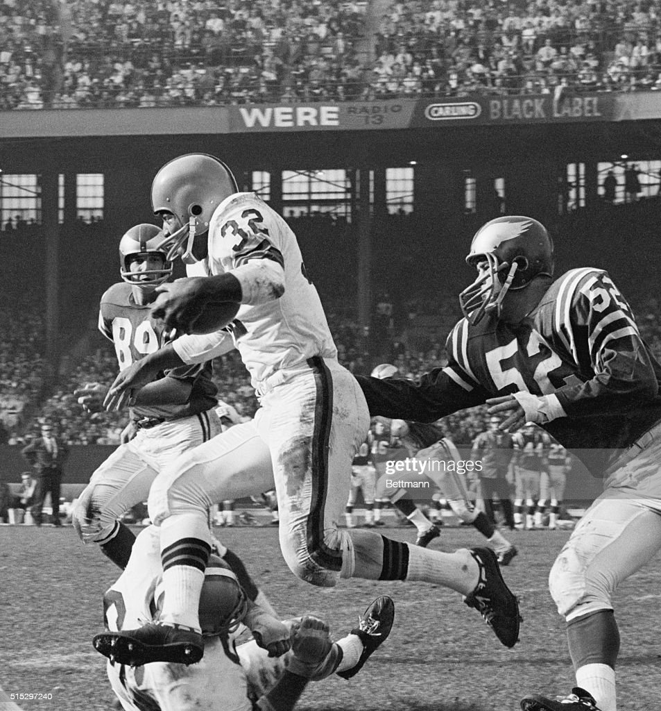 Browns fullback Jim Brown runs over Philadelphia Eagles' offensive tackle Gene Hickerson on his way to a first down during a game at Cleveland...