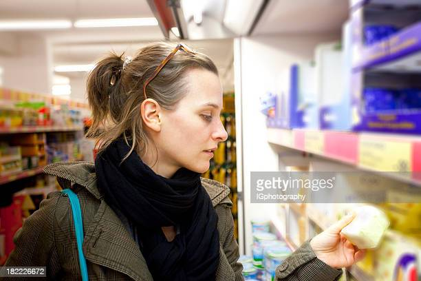 Browsing for Cheese in Supermarket