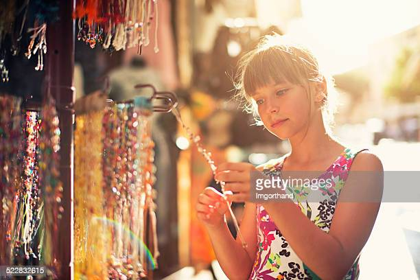 Browsing street jewelry stand
