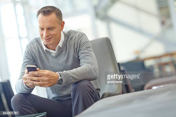 Browsing the web on his smartphone