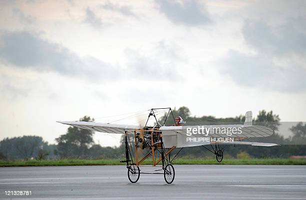 A BruayenArtois' aeromodeling club 12 scale replica of original Louis Bleriot monoplane takes off the airfield of the French northern town of Marck...
