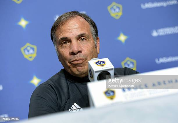 Bruce Arena coach Los Angeles Galaxy speaks during introduction of new Galaxy players Jelle Van Damme and Ashley Cole during a news conference at...