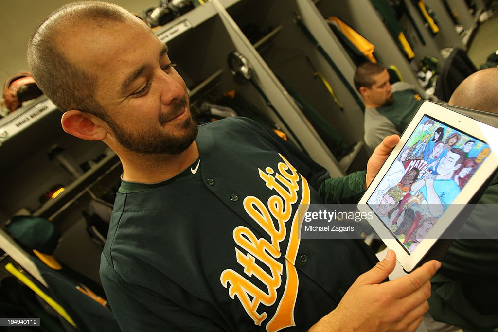 Bruce Billings #44 of the Oakland Athletics shows off his art in the clubhouse during a spring training workout at Phoenix Municipal Stadium on February 28, 2013 in Phoenix, Arizona.