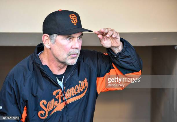 Bruce Bochy manager of the San Francisco Giants looks on before a baseball game against the San Diego Padres at Petco Park April 19 2014 in San Diego...
