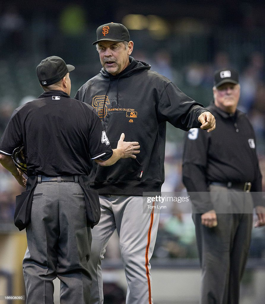<a gi-track='captionPersonalityLinkClicked' href=/galleries/search?phrase=Bruce+Bochy&family=editorial&specificpeople=220291 ng-click='$event.stopPropagation()'>Bruce Bochy</a> #15 manager of the San Francisco Giants talks with home plate ump Jerry Meals #41 after Carlos Gomez #27 of the Milwaukee Brewers was hit with a pitch in the second inning at Miller Park on April 18, 2013 in Milwaukee, Wisconsin.