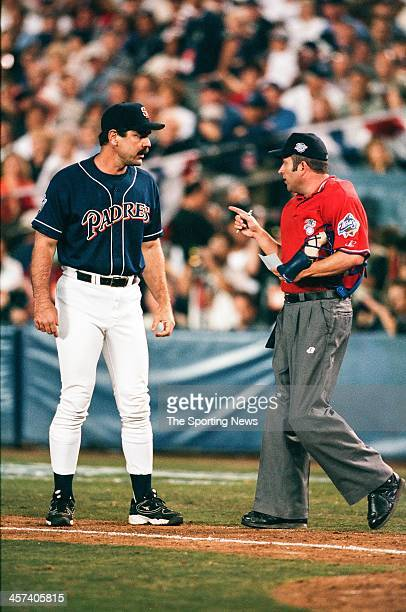 Bruce Bochy of the San Diego Padres talks with umpire Dale Scott during Game Three of the World Series against the New York Yankees on October 20...